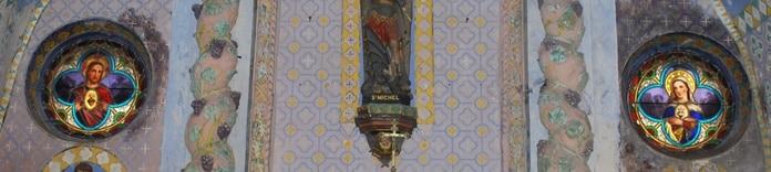 Le Christ et Marie au coeur flamboyant dans l'église de Fourtou